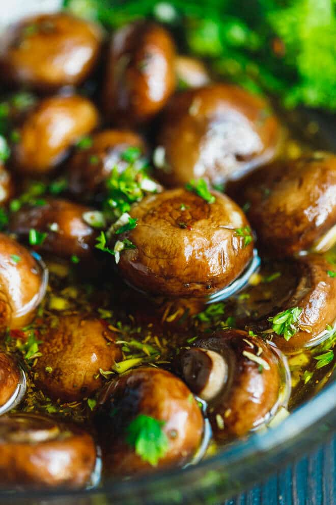 marinated mushrooms with the marinade in a bowl